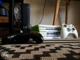 X box 360 plus 2 remotes plus 8 games brand new