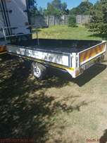 All purpose utility drop side trailer.