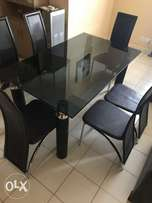 Six seater dining table and chairs.