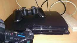 playstation 3(ps3) chipped with 10gameas and bth new pads