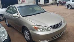 Tokumbo TOYOTA CAMRY 2004 model Very clean Gold Color, ACCIDENT FREE.