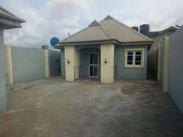 Executive 2 bedroom flat almost newly built setback on a tarred road