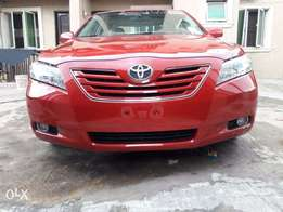 Tomato Red Accident Free 2009 Xle Toyota Camry with 4 plugs