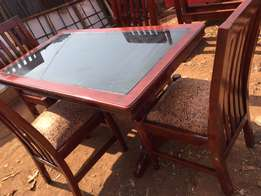 dining set, 4/6/8 Seater chairs available, table has a glass.