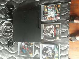 PS3 for sale plus driving force pro steering wheel
