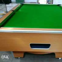Standard pool table with Mable top and coin operated