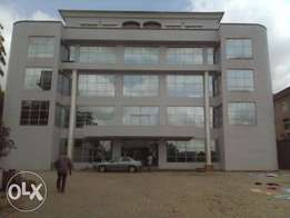 A newly built plaza available for sale in a central area of Abuja.