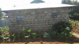 Half an acre for sale with a house going for 5m with ready title deed