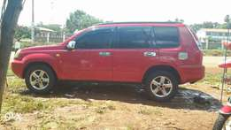 Clean, wine red Xtrail for sale.