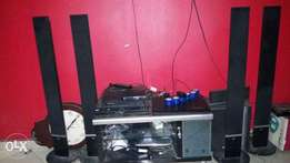 DVD player with four speakers, remote and TV stand