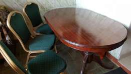 Authentic hardwood dinning table plus six chairs