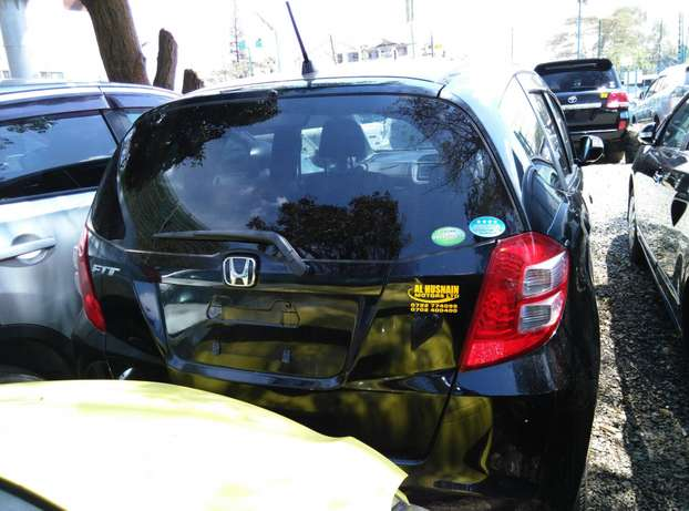 Black 2009 Honda Fit,1300CC,Grey Interiors,Dvd Player,Alloy rims Wheel Nairobi CBD - image 6