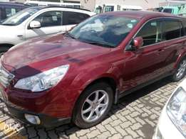 KCP 2010 model Outback just arrived color redwine with foglights