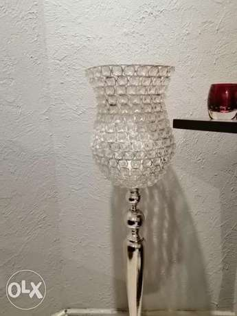 Rich silver self standing candle holder from life style