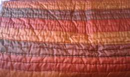 Satin bedspread in rusty colour