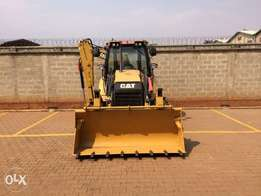 A multpurpus backhoe CAT UBA 906Z model 2014 for sale at 120,000 USD