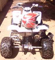Yamaha blaster 200cc with helmet and Fly boots