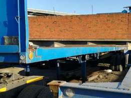 12M flat deck double axle trailer