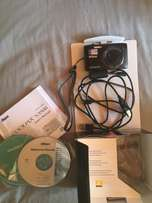 Digital camera with box, cds and all accessories