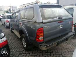 Dark blue Toyota Hilux Double cab. KCN number