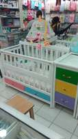 A wooden baby cot