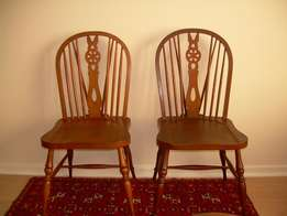 Two Windsor style dining room chairs in oak