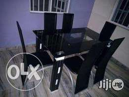 New quality six seaters glass dining table set