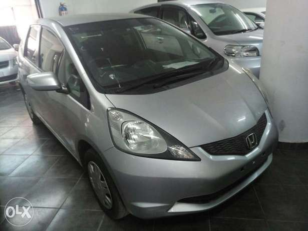 2011 model Honda Fit Silver, white n black all KCP number Mombasa Island - image 3