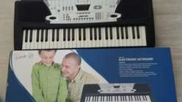 54-key electronic keyboard in box still with metal stand-Beacon Bay