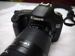 Canon EOS 60D with 18-135mm lens. Brand new