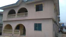 Decent 3 bedroom flat all round tiles with wardrobe store at igando