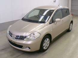 Nissan tiida Gold colour 2010 model excellent condition amazing deal