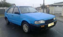 Mazda 323 1.3 in good driving condition,fuel saver.R11,500neg