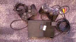 Clean chipped PS2 with two controllers and can use flash to play games