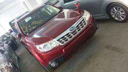 Subaru Forester with sunroof fully loaded maroon colour
