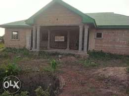 Uncompleted bungalow (4 rooms ensuite) with two bedroom bq