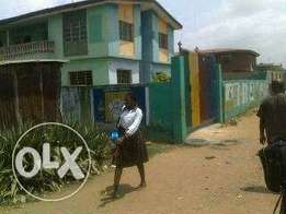 A block of 4nos 3bedroom flat at ikotun currently use for school.
