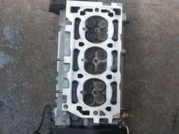 Various cylinder heads and other parts