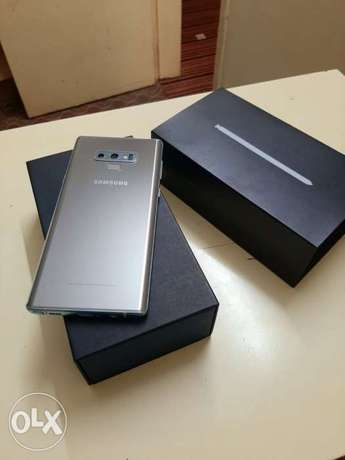 Samsung note 9 128gb with box and all accessories original with warran