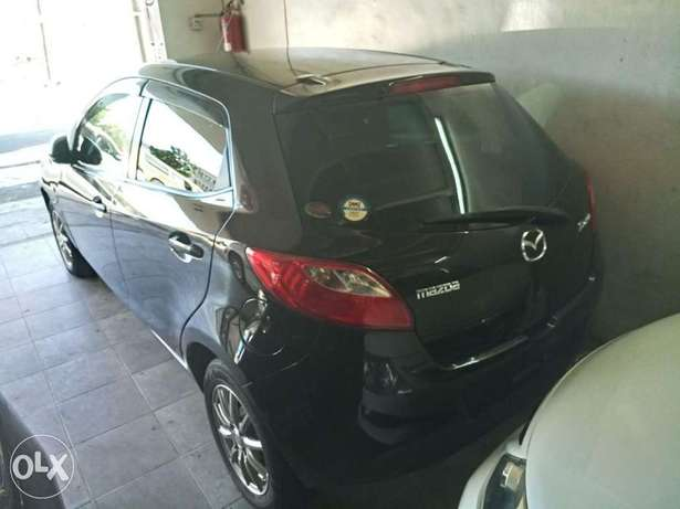 2010 model silver and black Mazda Demio for sale KCP number Mombasa Island - image 2