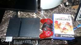 Playstation 2 with games and 2 controllers and memory card and camera