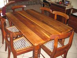 Solid blackwood dining table and riempies chairs.