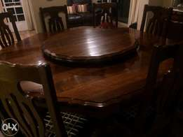 Beautiful Imbuia round dining room table & 8 chairs with sideboard and