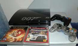 Ps3 slim 320 gig console + 2 controls + 2 games and all cables