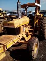 2003 New Holland tractor with crane