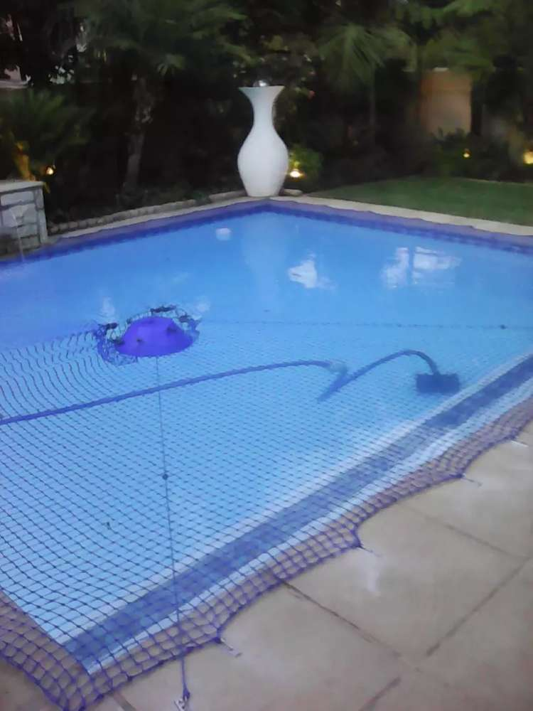 Swimming Pool safety nets n leaf catchers and solid covers
