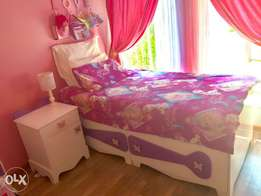 Girl bed for sale. Includes bedside cabinet and memory foam mattress