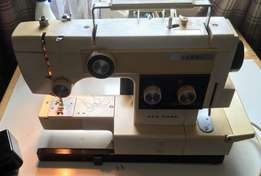 New home combi two in one sewing machine / overlocker,in good condit