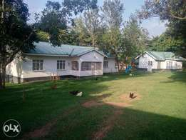 4 Acres Land, 5 bedroom house, 3 roomed guest house