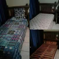 Wooden headboard with single base and matress very good condition